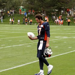 Brock Osweiler walks off at the end of practice.