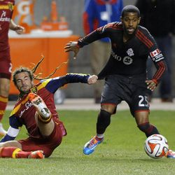 Real Salt Lake midfielder Kyle Beckerman (5) grabs the jersey of Toronto FC defender Jeremy Hall (25) while going down during a game at Rio Tinto Stadium in Sandy on Saturday, March 29, 2014.