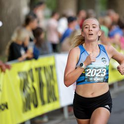 Angie Nickerson finishes third in the women's division of the Deseret News 10K at Liberty Park in Salt Lake City on Friday, July 23, 2021.