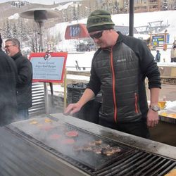 Texas chef Tim Love, decked out in his mountain look, grills up his signature Dirty Love Burgers.
