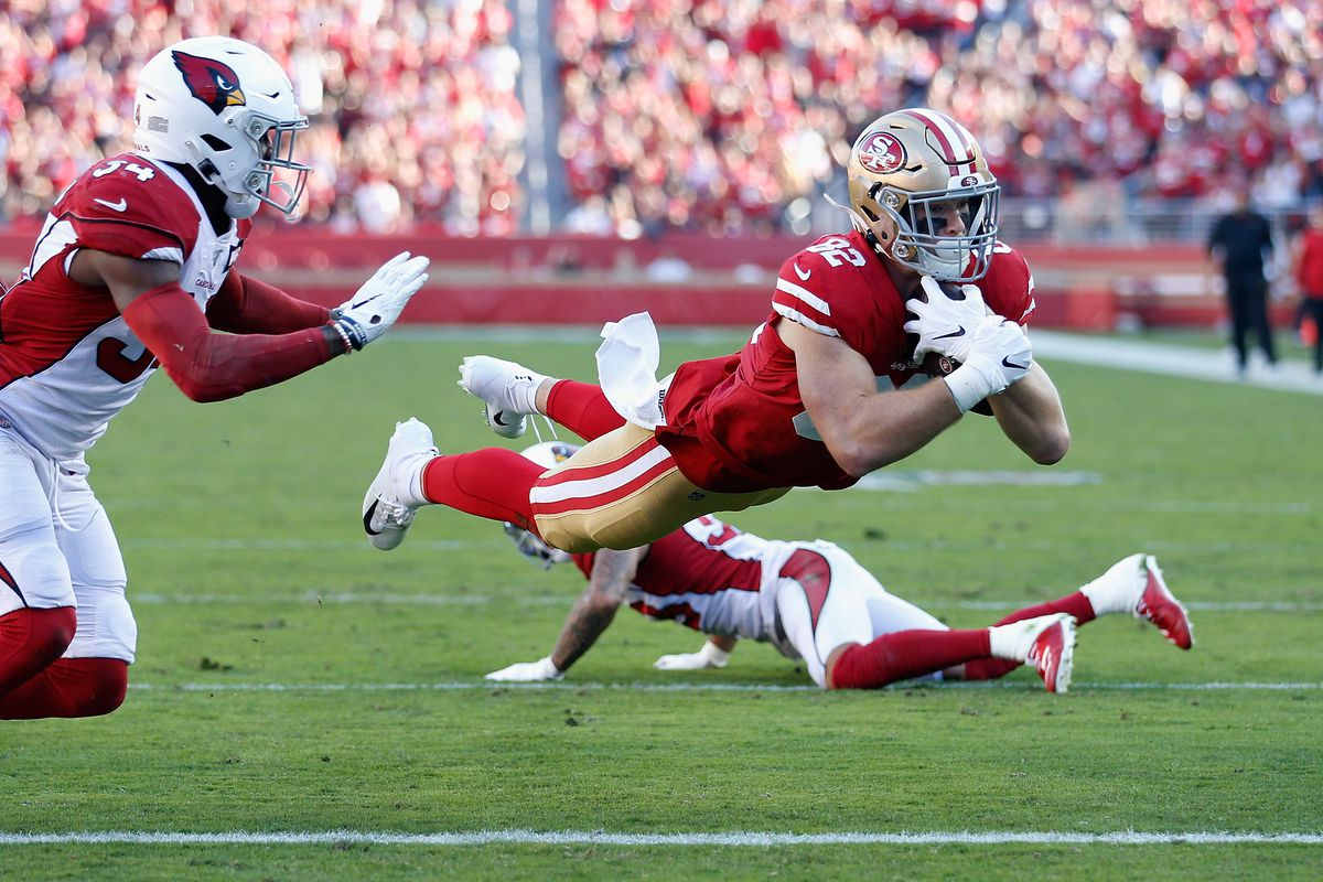 Tight end Ross Dwelley of the San Francisco 49ers dives into the endzone after a reception against the Arizona Cardinals during the first half of the NFL game at Levi's Stadium on November 17, 2019 in Santa Clara, California.