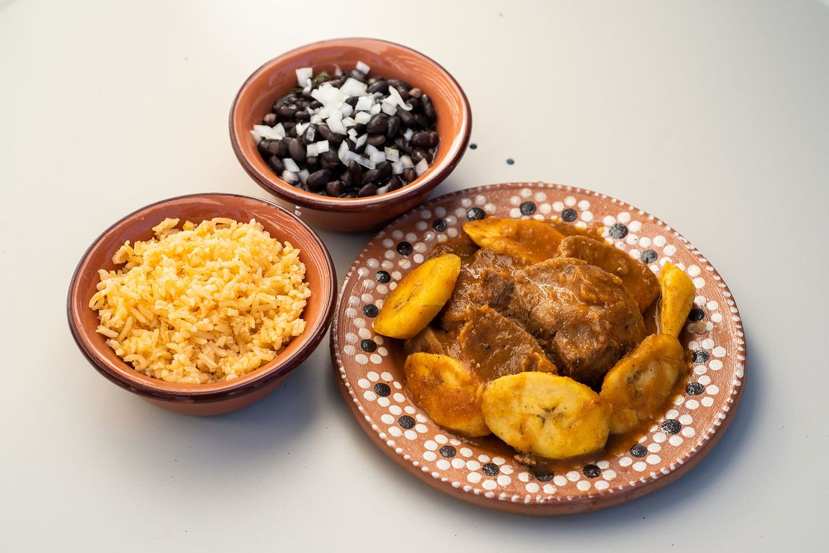 Beef tongue with plantains with rice and beans.