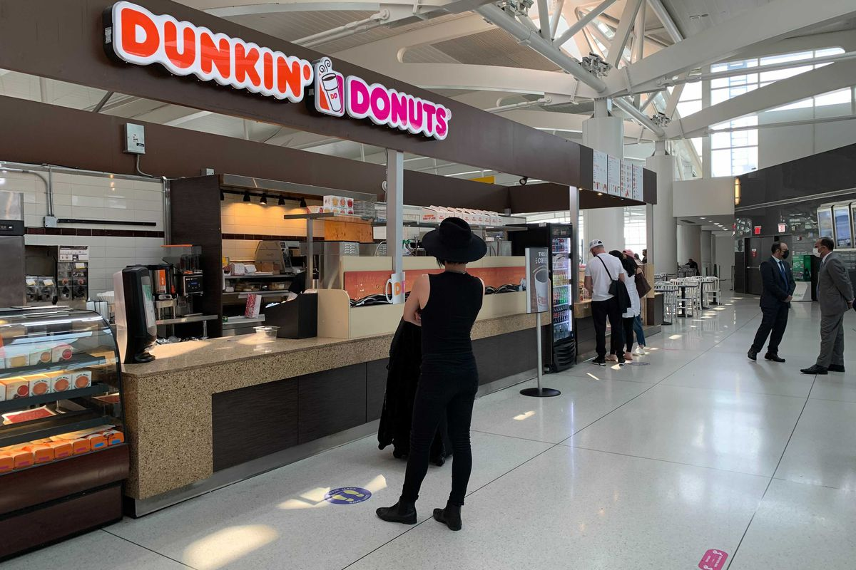 People wait for food at JFK Airport's Terminal 1, July 27, 2021.