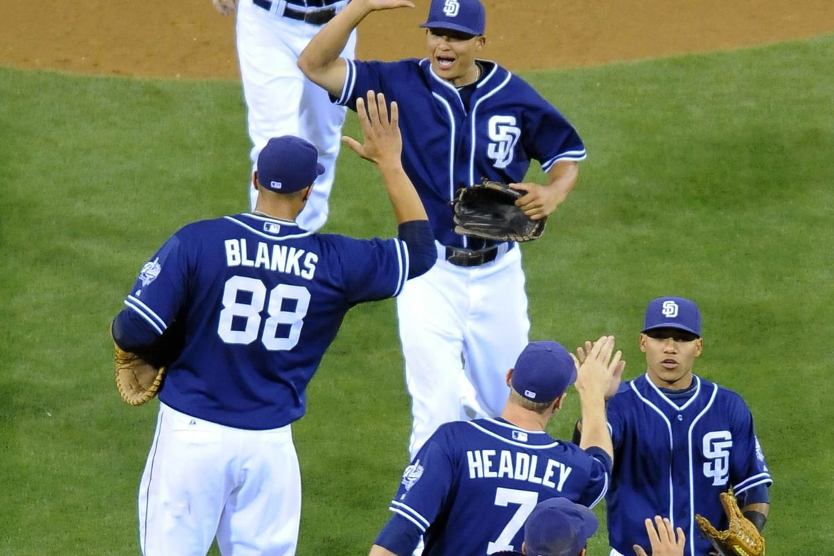 Padres slap hands. They did that a lot last week.