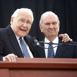 Elder L. Tom Perry, left, and Elder Russell M. Nelson speak to and encourage youth performers before the celebration.