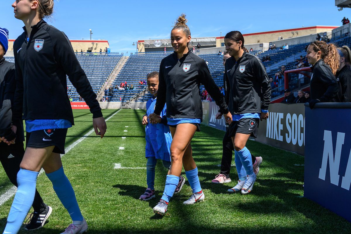 Caiden walks out with his mother Sarah Gorden before the Red Stars match against Reign FC. (Daniel Bartel/ISIPhotos.com)