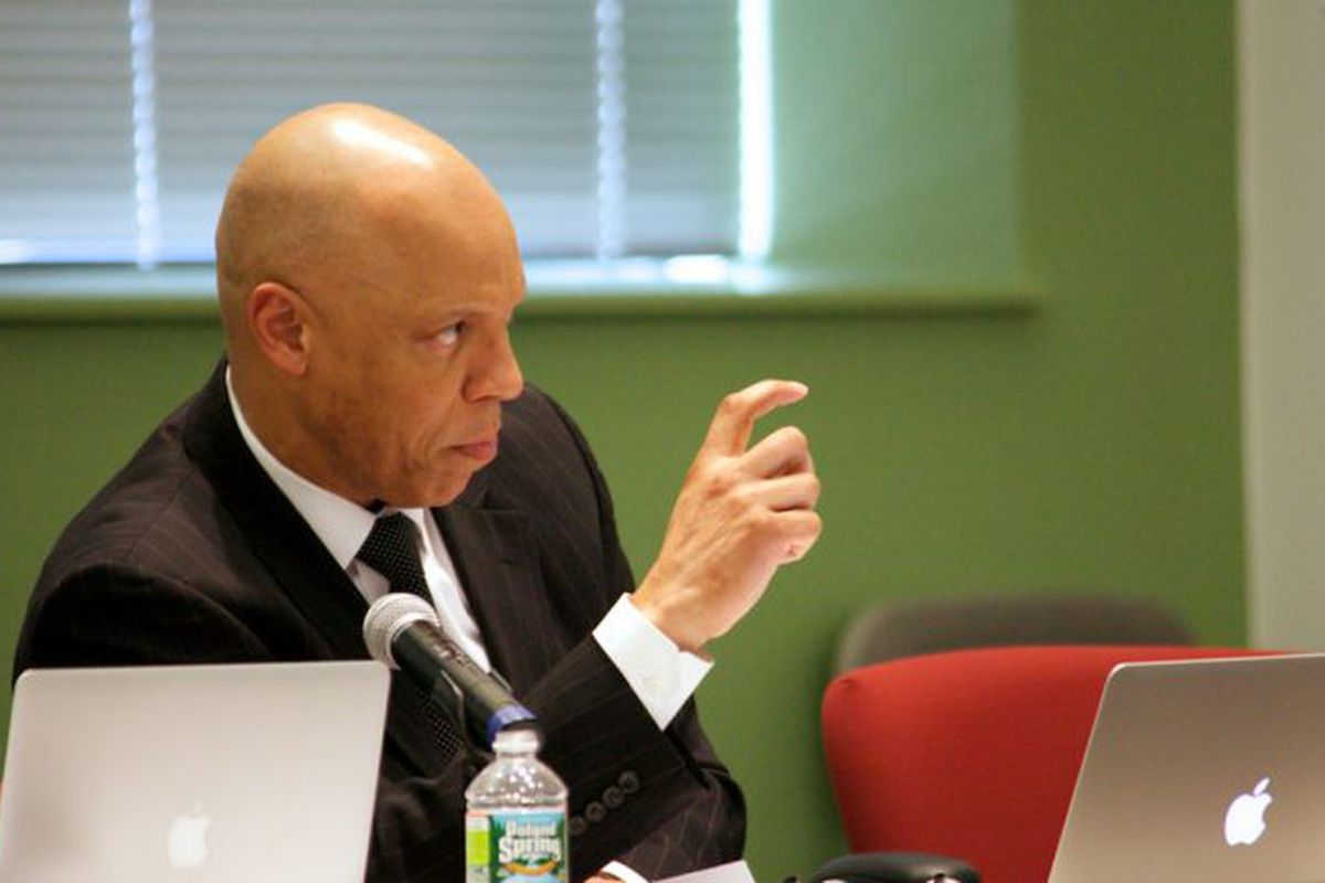 Philadelphia Superintendent William Hite looks forward while speaking at a desk with a laptop in front of him.