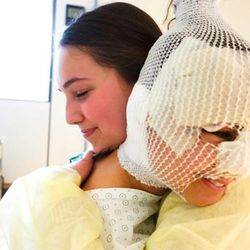 Sister Haylie VanDenBerghe, left, hugs Sister Fanny Rachel Clain, in a Belgian hospital. The two women are former companions in the France Paris Mission of the Church of Jesus Christ of Latter-day Saints. Sister Clain, who is French, was at the Brussels airport to catch her flight to her missionary assignment in Ohio when terrorists bombs exploded and wounded her on March 22, 2016.