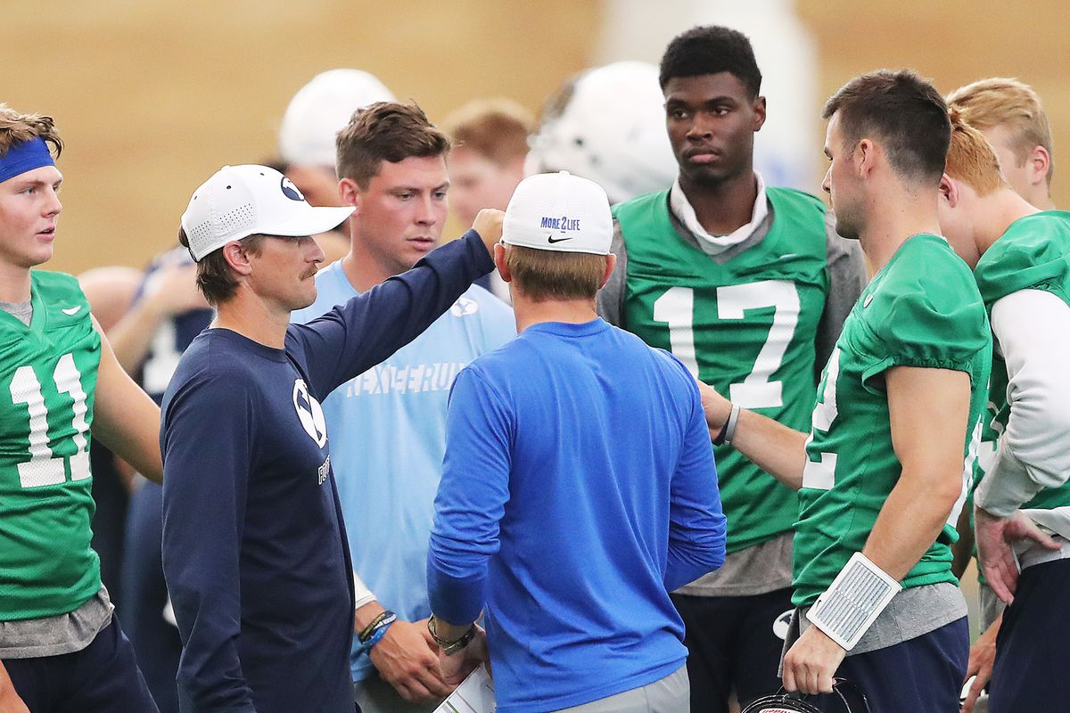 Passing Game Coordinator and Quarterbacks Coach Aaron Roderick gathers his players after a walkthrough in their indoor practice facility in Provo on Friday, Aug. 10, 2018.