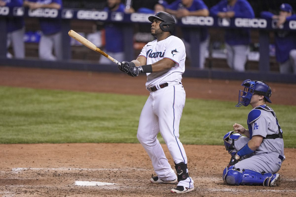 Jesus Aguilar #24 of the Miami Marlins hits a walk-off home run in the ninth inning against the Los Angeles Dodgers at loanDepot park