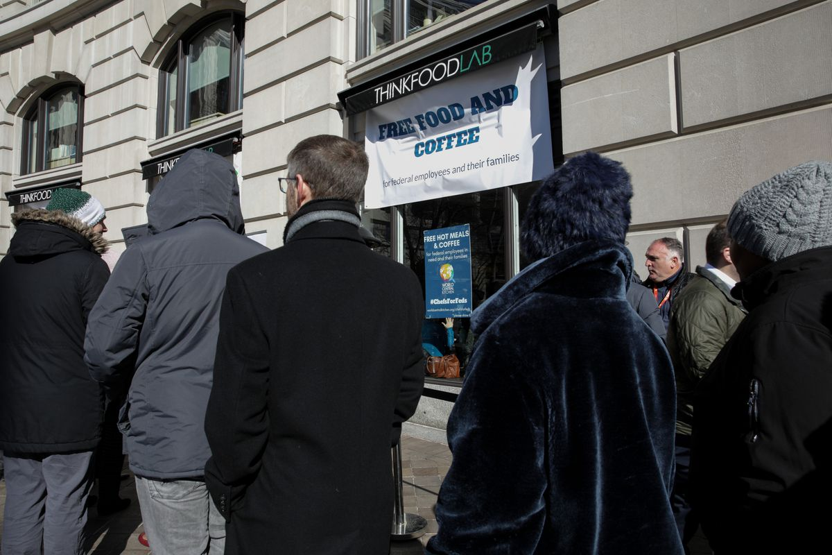 People line up outside Chef and activist Jose Andres's food-relief organization World Central Kitchen, which serves free meals and goods to federal workers who have been effected by the partial government shutdown, in Washington, United States on January