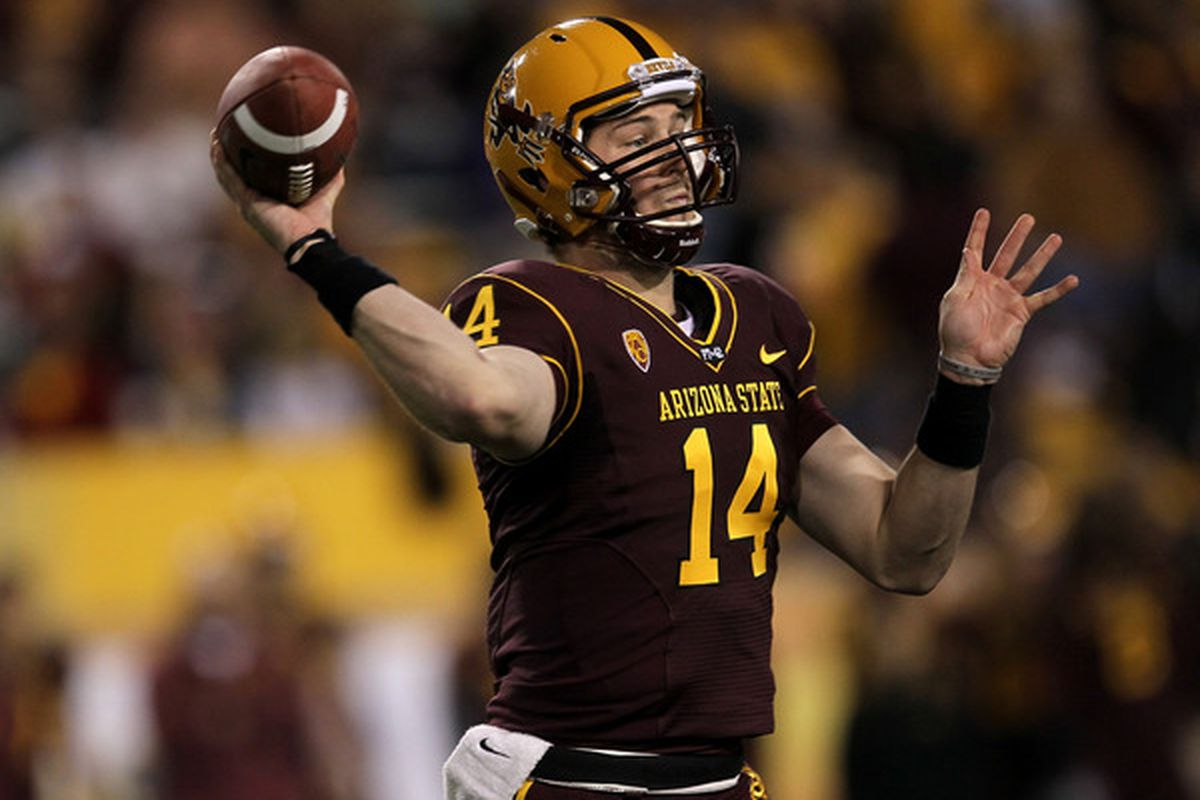 Quarterback Steven Threet #14 of the Arizona State Sun Devils throws a pass against the Stanford Cardinal at Sun Devil Stadium in Tempe, Arizona. (Photo by Stephen Dunn/Getty Images)