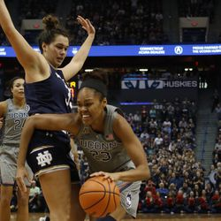 UConn's Azura Stevens (23) tries to drive past Notre Dame's Kathryn Westbeld (33) during the Notre Dame Fighting Irish vs UConn Huskies women's college basketball game in the Women's Jimmy V Classic at the XL Center in Hartford, CT on December 3, 2017.