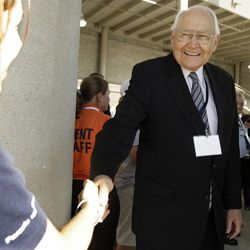 Elder L. Tom Perry, a member of the Quorum of the Twelve Apostles of The Church of Jesus Christ of Latter-day Saints, shakes hands before the BYU vs. University of Central Florida football game in Provo on Sept. 24, 2011.