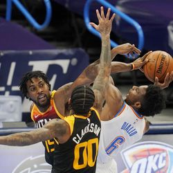 Oklahoma City Thunder guard Hamidou Diallo (6) is defended by Utah Jazz center Derrick Favors (15) and guard Jordan Clarkson (00) during the first half of an NBA basketball game in Oklahoma City, Monday, Dec. 28, 2020.
