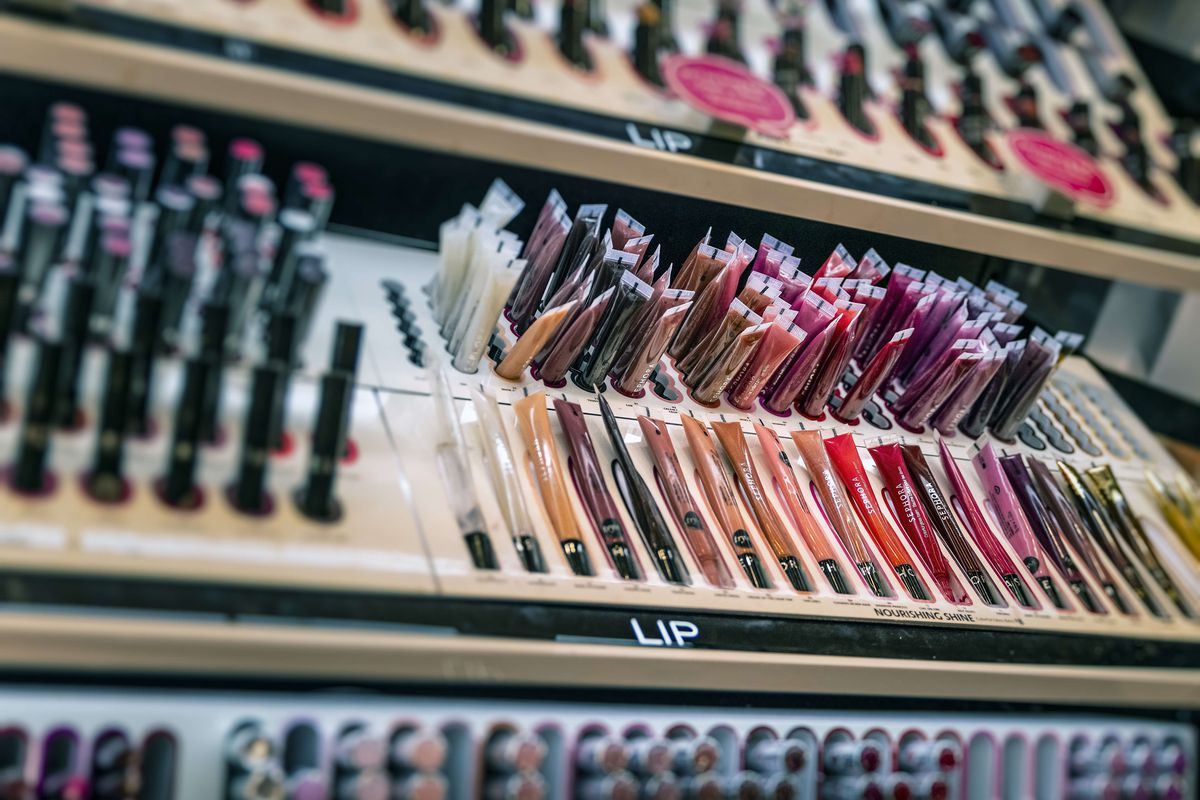 Lip gloss display in a Sephora personal care and beauty...