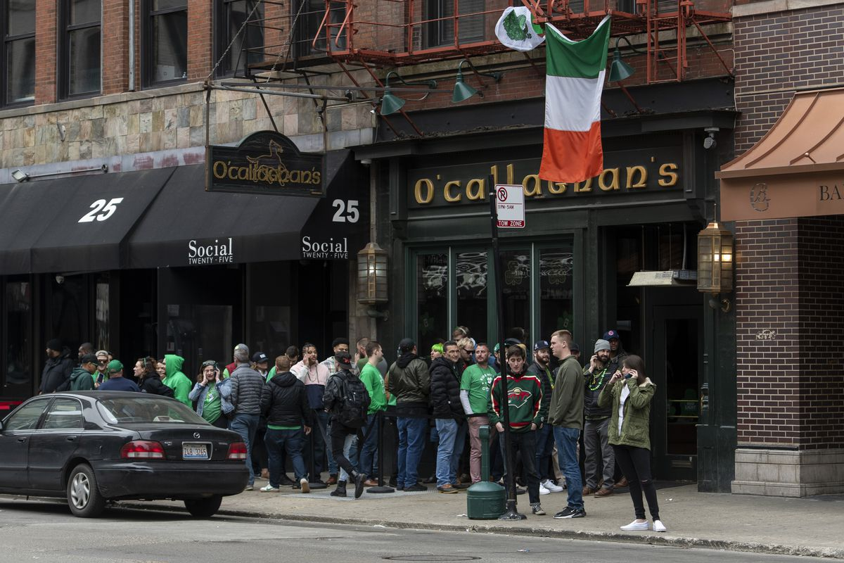 People celebrate St. Patrick's Day outside O'Callaghan's in River North on Saturday, even though the annual St. Patrick's Day parades were cancelled.