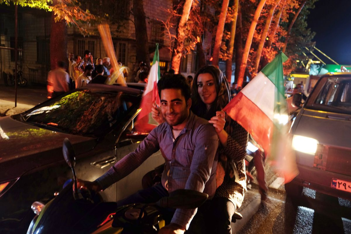 Iranians celebrate the announcement of the nuclear deal in the streets of Tehran (Kaveh Kazemi/Getty)