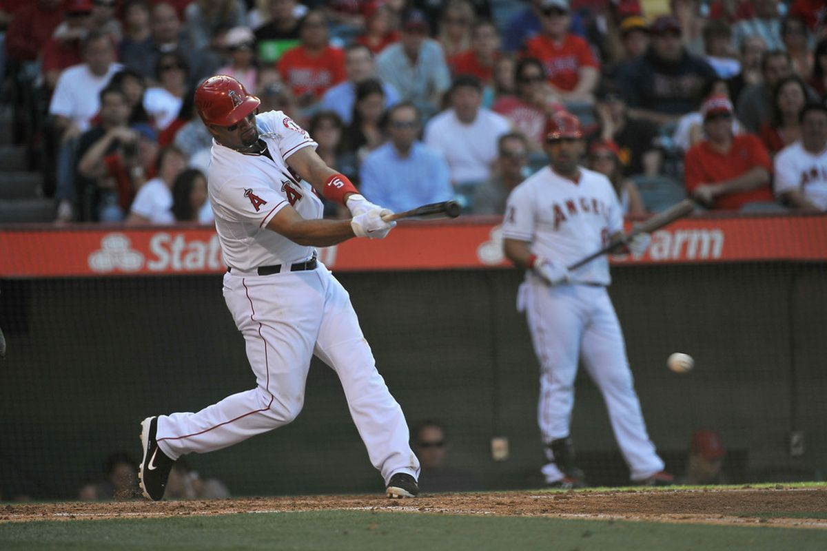 ANAHEIM, CA - MAY 15:  Albert Pujols #5 of the Angels of Anaheim hits an RBI single against the Oakland Athletics at Angel Stadium of Anaheim on May 15, 2012 in Anaheim, California.  (Photo by Jonathan Moore/Getty Images)