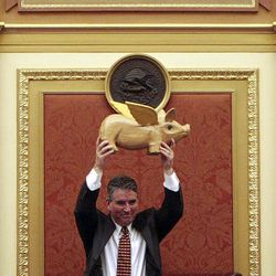 House Speaker Dave Clark, R-Santa Clara, holds up a flying pig he was given as the final session of the 2009 Utah Legislature comes to a close at the Capitol Thursday.
