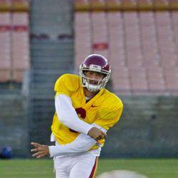 Cody Kessler fires on the run.