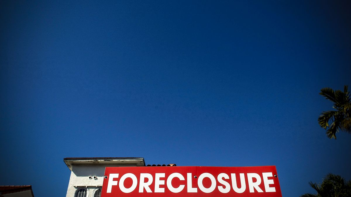 A foreclosure sign in front of a home in Miami Beach, Florida on January 22, 2009.