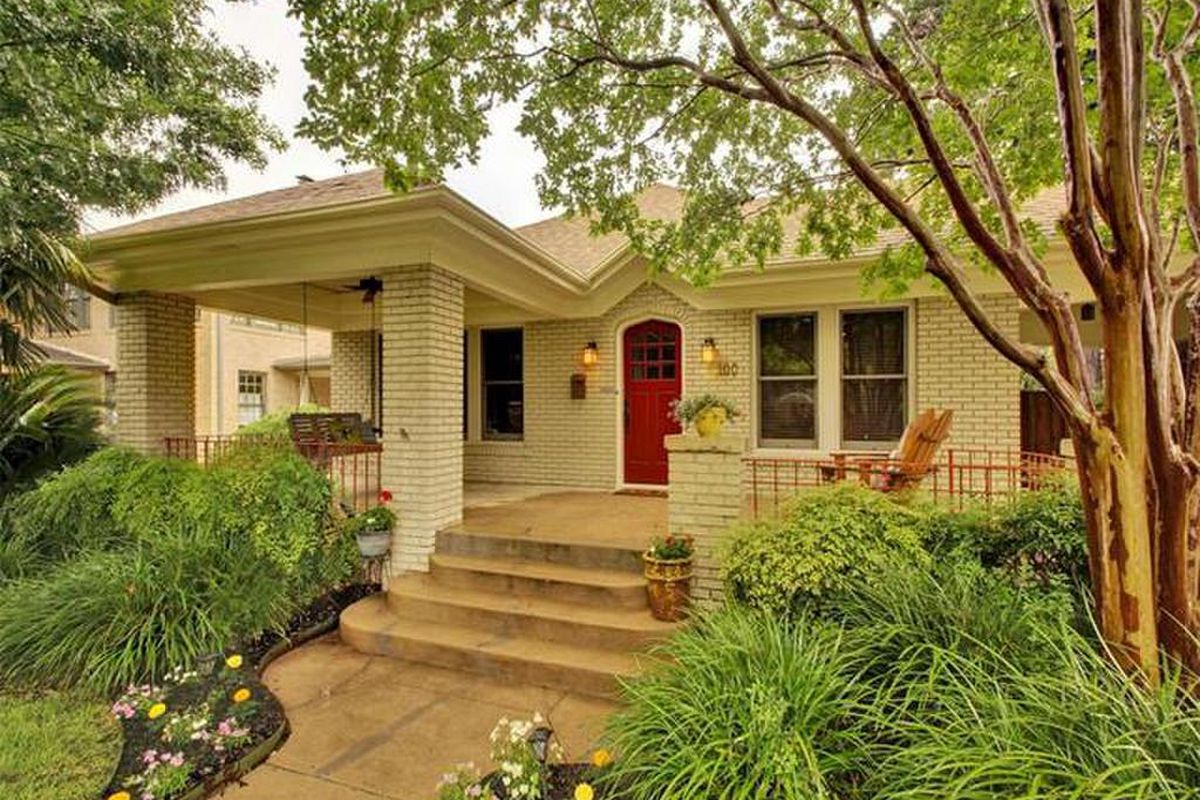 Modest but lovely yellowish brick Craftsman with big porch
