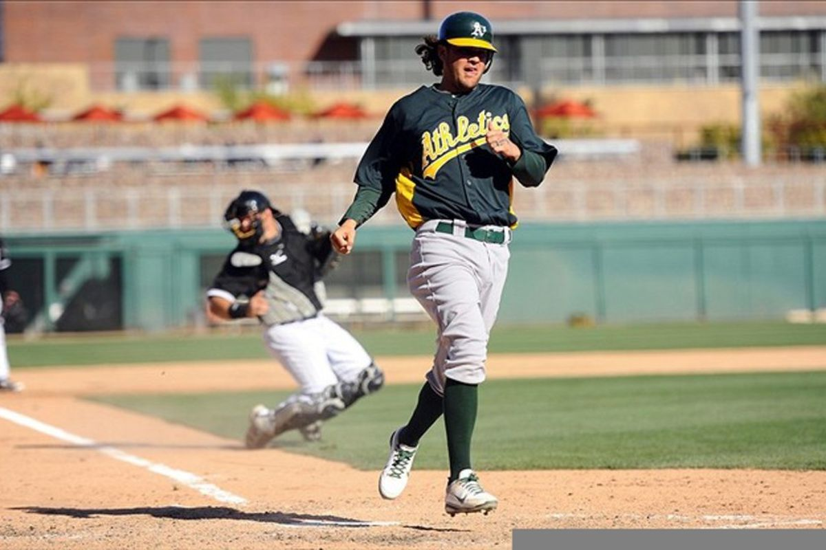 Mar 12, 2012; Glendale, AZ, USA; Oakland Athletics third baseman Wes Timmons (17) scores during the eighth inning against the Chicago White Sox at Camelback Ranch. Mandatory Credit: Christopher Hanewinckel-US PRESSWIRE