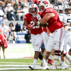 Wisconsin Badgers running back Jonathan Taylor (23) celebrates after running for a touchdown, putting the Badgers up 10-3 over Brigham Young Cougars after the PAT, during the game at LaVell Edwards Stadium in Provo on Saturday, Sept. 16, 2017.