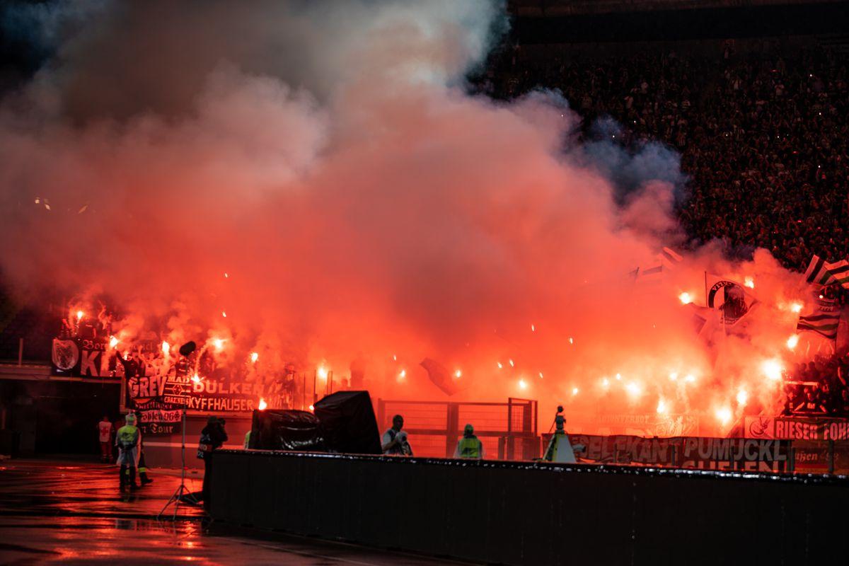Borussia Moenchengladbach fans light flares during the UEFA...