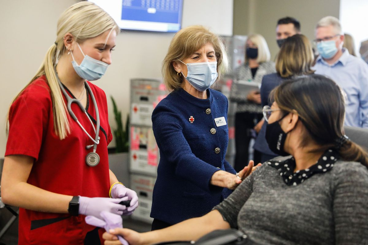 American Red Cross President and CEO Gail McGovern talks to a donor during a Red Cross blood drive at BYU in Provo, Utah.