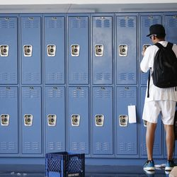 A homeless youth uses a locker at Volunteers of America's Youth Resource Center in Salt Lake City on Thursday, Sept. 15, 2016.