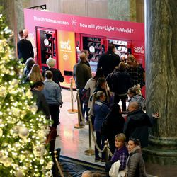 Visitors to the Joseph Smith Memorial Building in Salt Lake City stop at the Light the World charity vending machines on Friday, Dec. 15, 2017.