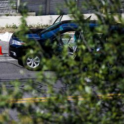 A vehicle sits along Alta Canyon Drive following a shooting in Sandy that killed three and hospitalized two on Tuesday, June 6, 2017.