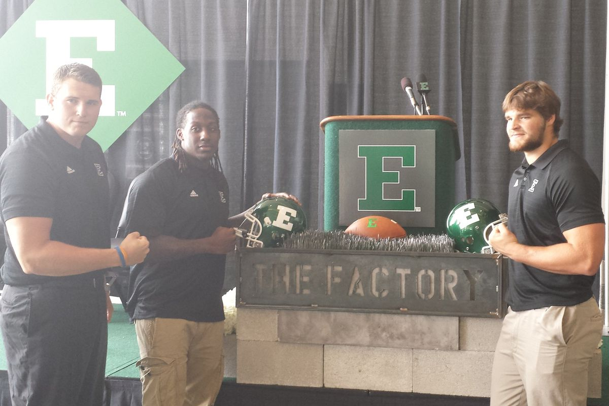 """EMU captains (left to right) Lincoln Hansen, Pudge Cotton and Pat O'Connor at the unveiling of """"The Factory"""" at Eastern Michigan."""
