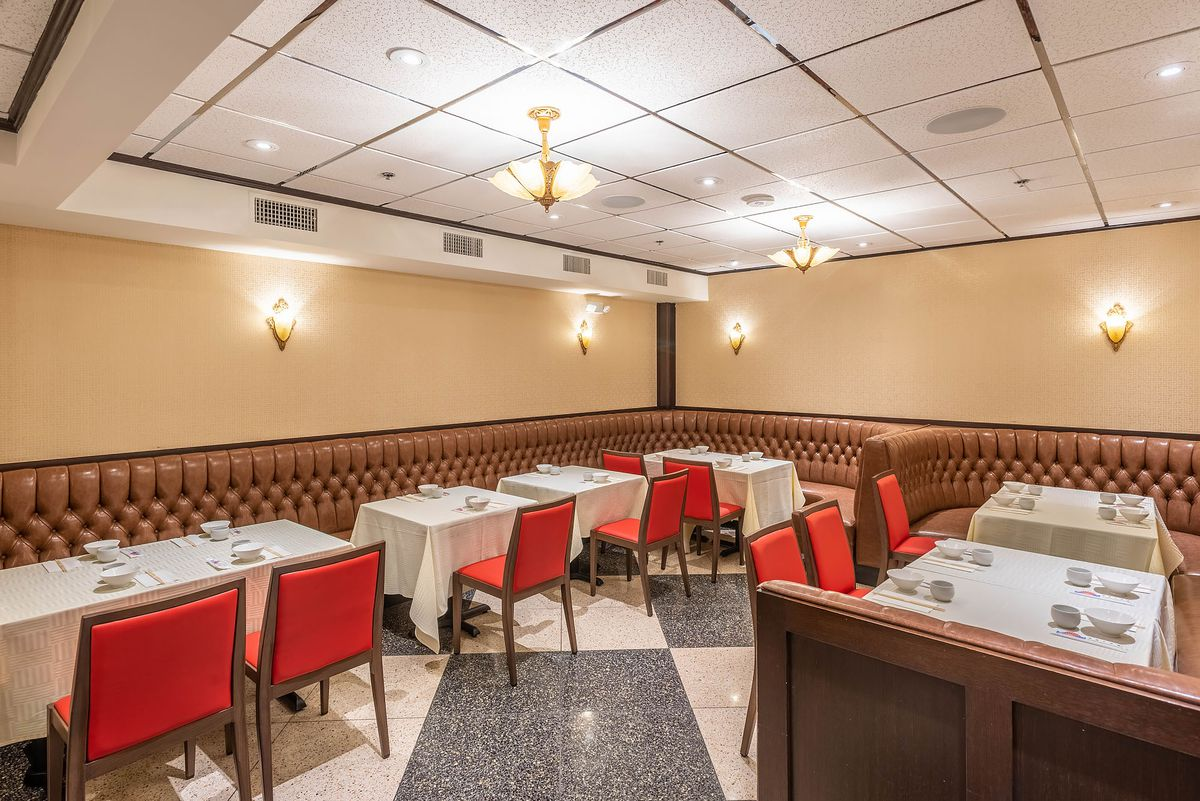 Chef Tony restaurant in Pasadena dining room with red chairs and plush banquettes in a brightly lit room.