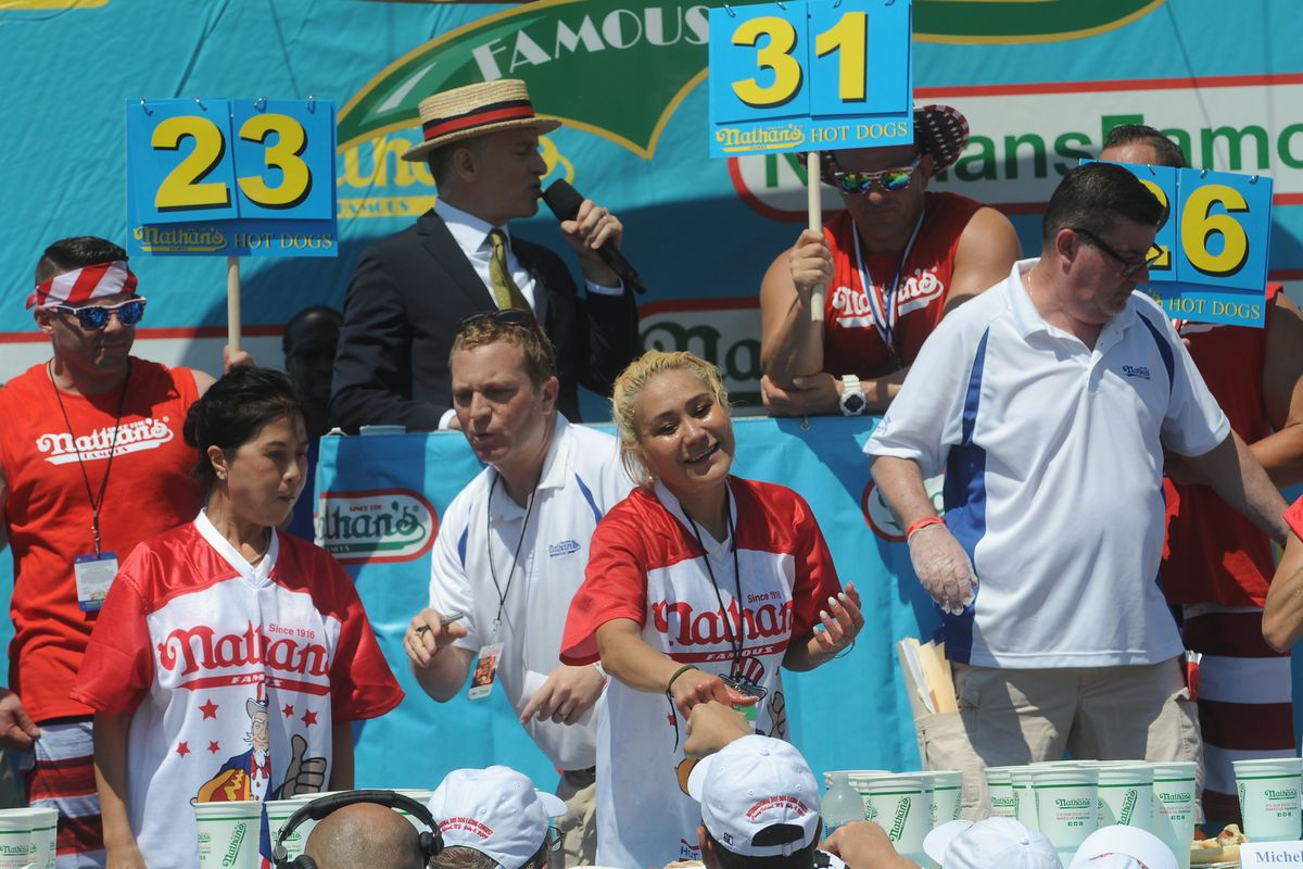 Juliet Lee and Miki Sudo compete in the women's competition at the 2019 Nathans Famous Fourth of July International Hot Dog Eating Contest at Coney Island on July 4, 2019 in the Brooklyn borough of New York City.