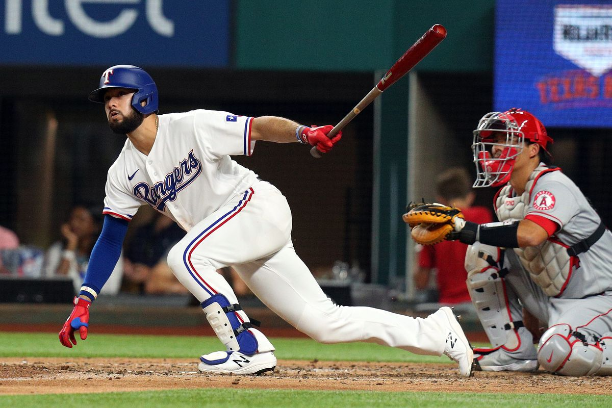 Isiah Kiner-Falefa #9 of the Texas Rangers hits a double against the Los Angeles Angels in the sixth inning at Globe Life Field on August 04, 2021 in Arlington, Texas.
