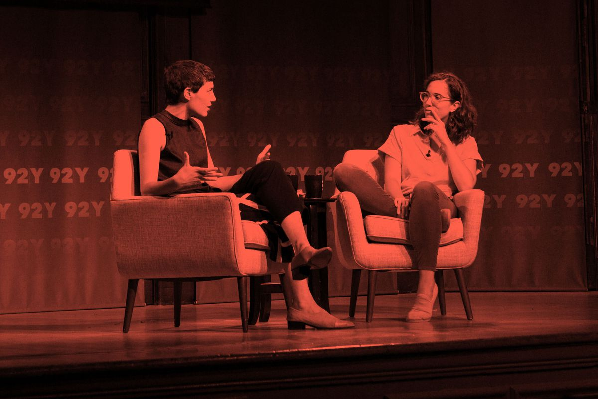 Avery Trufelman and Caity Weaver sitting in chairs and speaking animatedly on the stage of 92Y in New York City