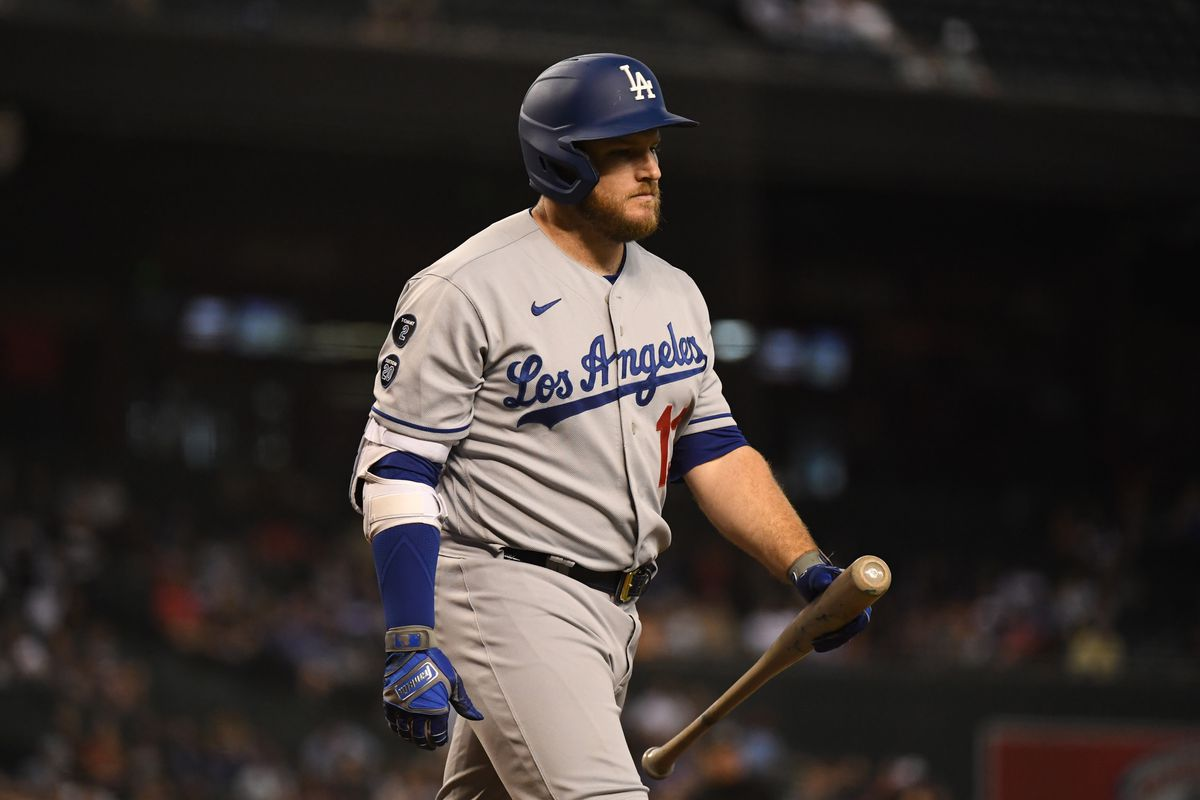 Max Muncy #13 of the Los Angeles Dodgers walks back to the dugout after an at bat against the Arizona Diamondbacks at Chase Field on September 26, 2021 in Phoenix, Arizona.