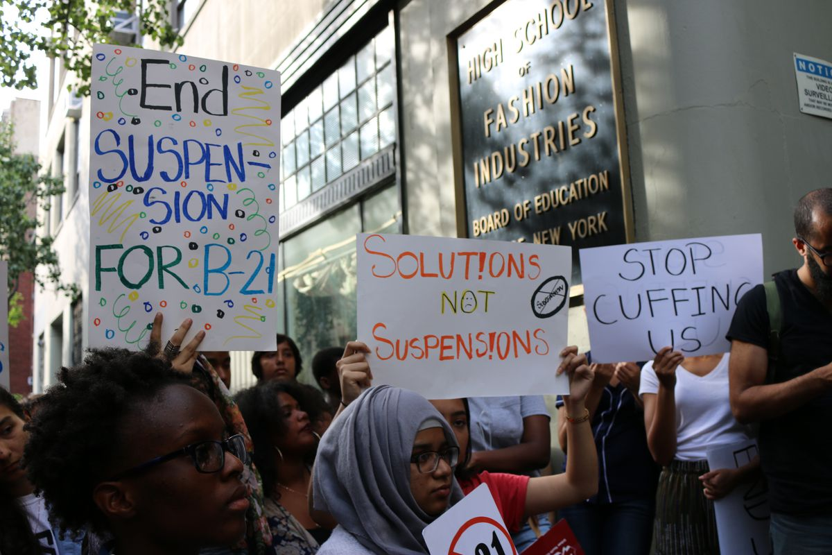 Advocates protested the city's suspension policy.