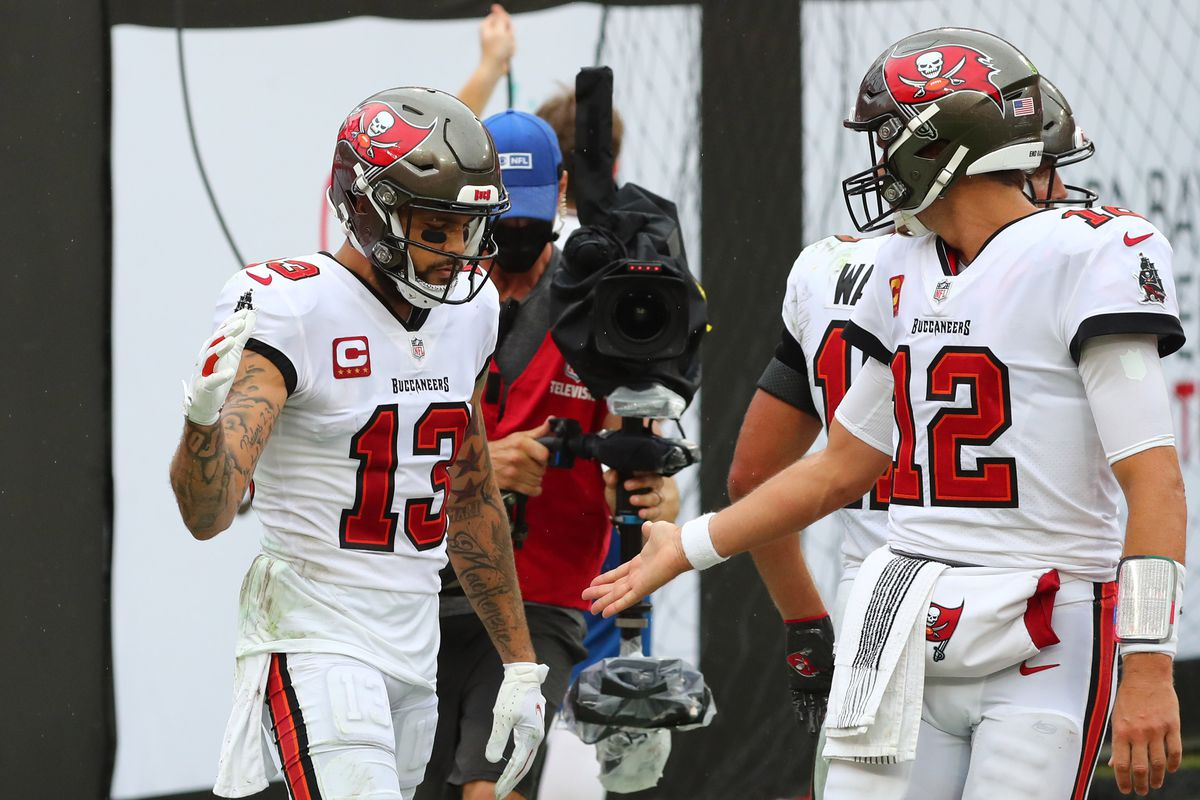 Tampa Bay Buccaneers wide receiver Mike Evans (13) celebrates a touchdown with quarterback Tom Brady (12) against the Los Angeles Chargers in the second quarter of a NFL game at Raymond James Stadium.