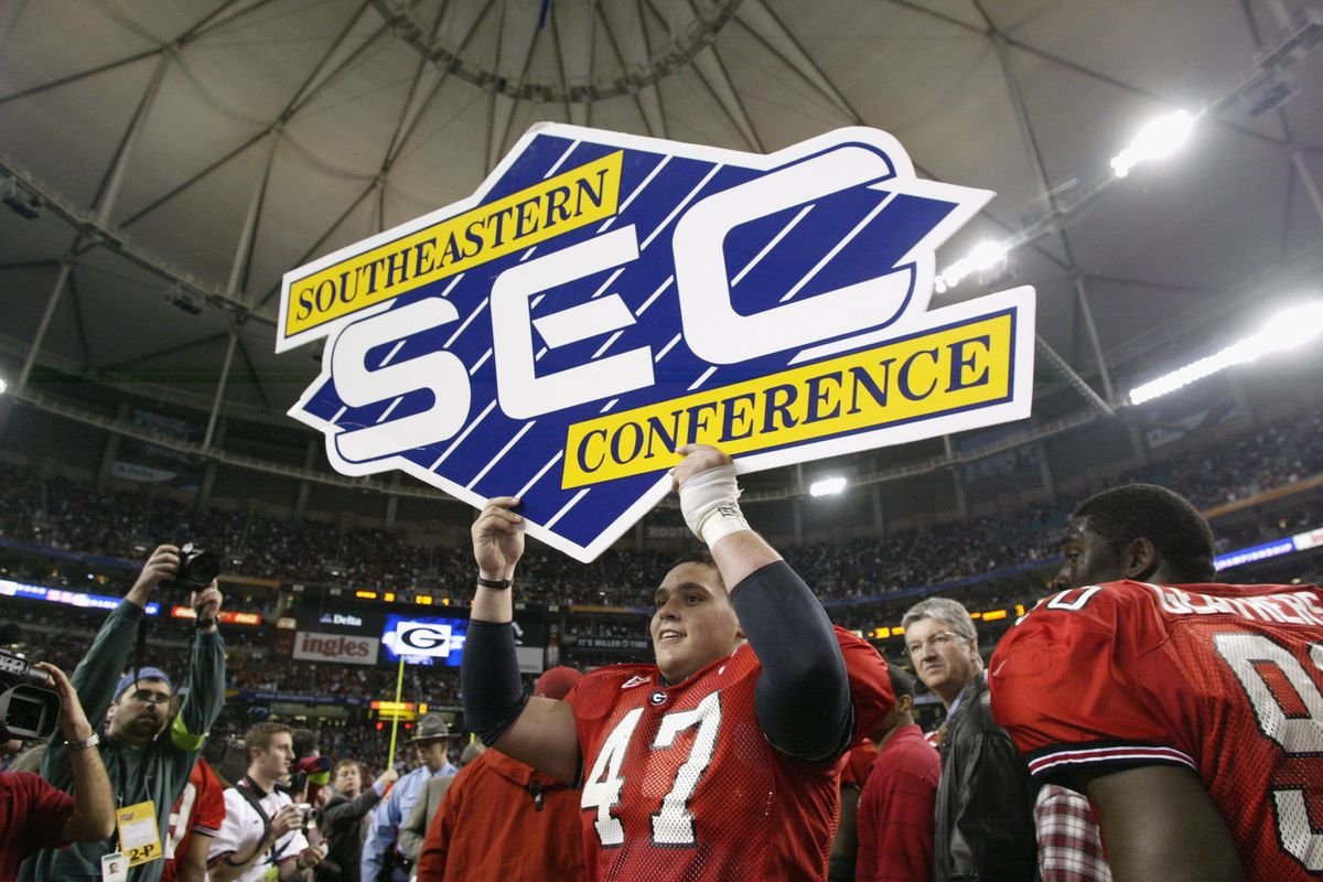 David Pollack holds a SEC sign
