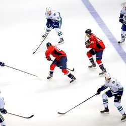 Beagle and Wilson Surrounded by Canucks