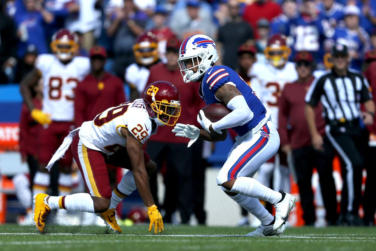 Gabriel Davis #13 of the Buffalo Bills runs after the catch against Kendall Fuller #29 of the Washington Football Team in the first quarter of the game at Highmark Stadium on September 26, 2021 in Orchard Park, New York.