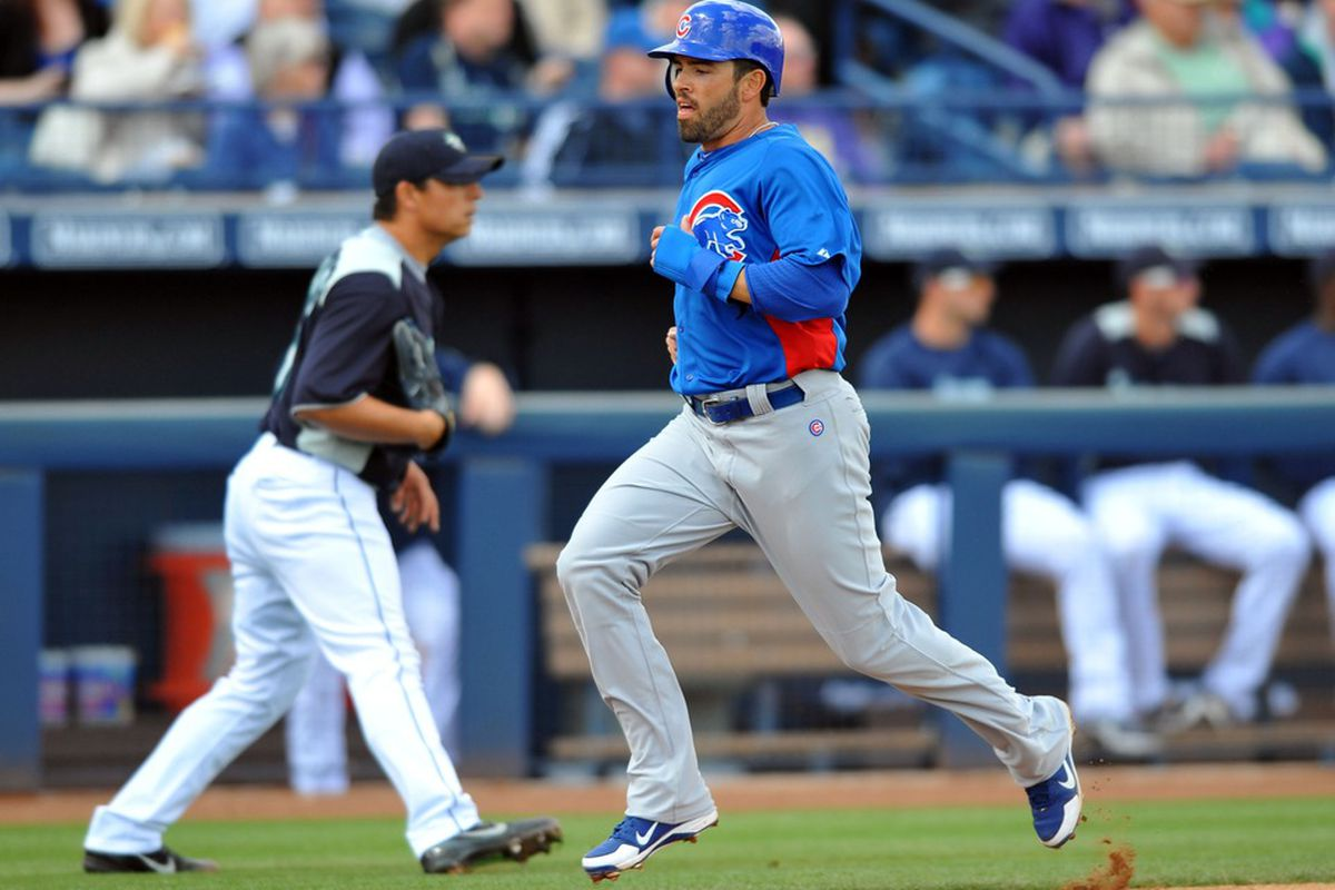 Peoria, AZ, USA;  Chicago Cubs right fielder David DeJesus scores during the first inning against the Seattle Mariners at Peoria Stadium. Mandatory Credit: Christopher Hanewinckel-US PRESSWIRE