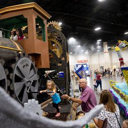 Hailey Colling, 4, turns a gear on a float depicting a train by the South Jordan Garden Park Stake during the Days of '47 Float Preview Party at the Mountain America Expo Center in Sandy on Tuesday, July 20, 2021.