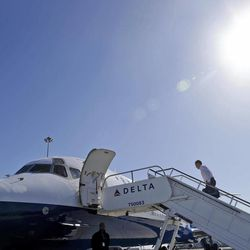 Republican presidential candidate and former Massachusetts Gov. Mitt Romney boards his campaign plane in San Francisco ,Saturday, Sept. 22, 2012.