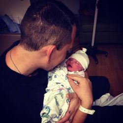Brad Hancock, 23, was shot and killed outside of a concert in the parking lot of At The Core Nov. 15, 2014. Here, he is pictured with his son