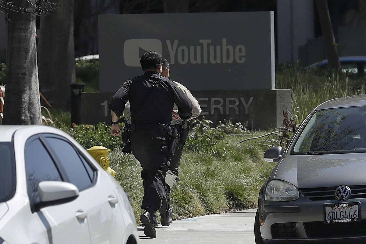 Officers run toward YouTube offices in San Bruno, California, on Tuesday, April 3, 2018. Police and federal officials have responded to reports of a shooting Tuesday at YouTube headquarters in Northern California.